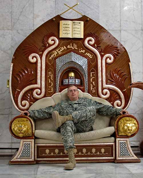 Yet another American soldier sitting on Saddam's throne.